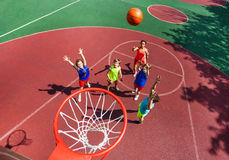 Flying ball to basket top view during basketball Stock Photos