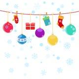 Fond de Noël avec les boîte-cadeau accrochants, chaussettes Photographie stock libre de droits