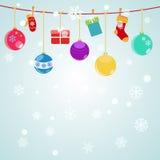 Fond de Noël avec les boîte-cadeau accrochants, chaussettes Images stock