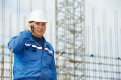 Foreman at construction site with mobile phone Stock Images