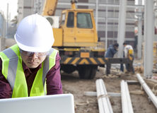 Foreman construction site using laptop Stock Image