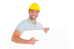 Foreman pointing at blank board on white background Royalty Free Stock Images