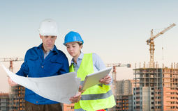 Foreman and student with blueprints Stock Images