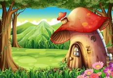 A forest with a mushroom house Stock Photos