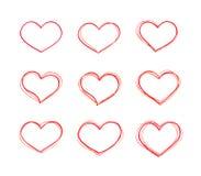 Formas rojas del corazón del vector a mano fijadas Imagen de archivo libre de regalías