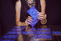 Fortune teller forecasting the future with tarot cards Royalty Free Stock Photo