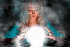 Fortune teller woman with light sphere in her hands Royalty Free Stock Photography