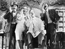 Four men at a barber shop singing Royalty Free Stock Images