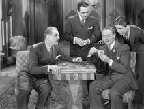 Four men playing cards Royalty Free Stock Photography