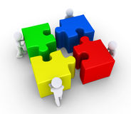 Four people join the big puzzle pieces Royalty Free Stock Image