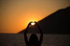 Free happy woman enjoying sunset..Embracing the golden sunshine glow of sunset,enjoying peace,serenity in nature.Vacation vitality Royalty Free Stock Photo