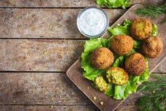 Fresh chickpeas falafel  with tzatziki sauce Royalty Free Stock Photos