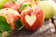 Fresh red apple with heart cutout Royalty Free Stock Images