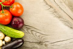 Fresh vegetables on wooden background. The icon for healthy eating, diets, weight loss. Stock Photo