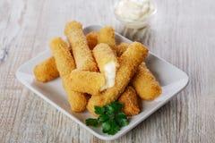 Fried mozzarella cheese sticks Stock Images