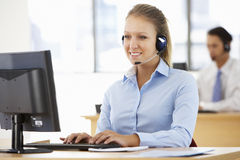 Friendly Service Agent Talking To Customer In Call Centre Royalty Free Stock Image