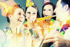 Friends partying in cocktail bar with hats Stock Photography