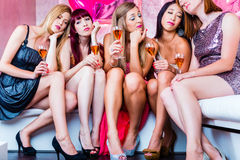 Friends partying in night club until sleep Stock Photography