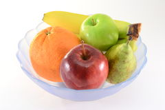 Fruits in a bowl Stock Images