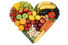 Fruits and vegetables forming heart love topic and healthy eatin Stock Image