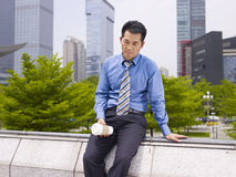Frustrated asian business executive Stock Image