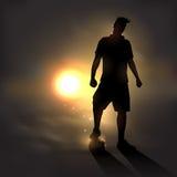 Fußballspieler bei Sonnenuntergang Stockfotos