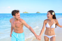 Fun on beach - couple in a happy relationship Royalty Free Stock Images