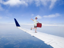Fun and Funny Tourist Travel Flying on Airplane Jet Wing Royalty Free Stock Photos