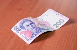 Fundo ucraniano do dinheiro feito de dois cem notas do hryvnia Fotografia de Stock