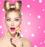 Funny girl eating lollipop Royalty Free Stock Photos
