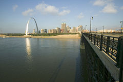 Gateway Arch and skyline of St. Louis, Missouri at sunrise from bridge in East St. Louis, Illinois on the Mississippi River Royalty Free Stock Photo