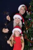 Gelukkige familie met lichten Royalty-vrije Stock Foto's