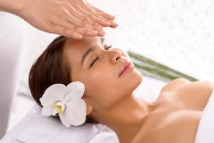 Getting reiki therapy Royalty Free Stock Image