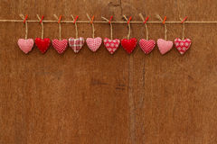 Gingham Love Valentine's hearts hanging on wooden texture backgr Royalty Free Stock Photography