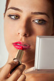 Girl Applying Lipstick Royalty Free Stock Image