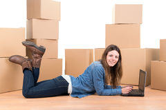 Girl with boxes Stock Images