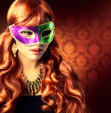 Girl in a Carnival mask Stock Images