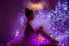 Girl Child, Christmas Tree Lights, Kid in Holiday Night Stock Photo