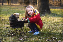 Girl with dog and pram  Stock Image