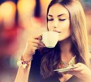 Girl Drinking Tea or Coffee Stock Photography