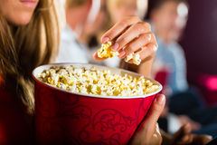 Girl eating popcorn in cinema or movie theater Royalty Free Stock Images