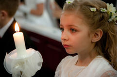 Girl at first holy communion Stock Photo