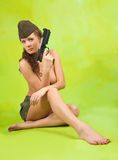 Girl in garrison cap with gun Royalty Free Stock Photo