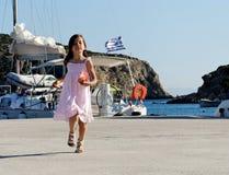 Girl in Greek harbor Royalty Free Stock Photo