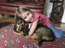 Girl with her pet dog Stock Image