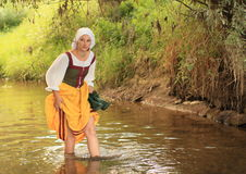 Girl in historical dress in water Royalty Free Stock Photography