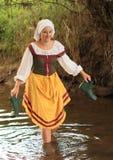 Girl in historical dress in water Stock Image
