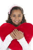 Girl holding a heart shaped pillow in her arms Royalty Free Stock Photo
