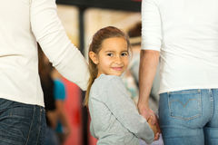 Girl holding parent's hands Stock Image