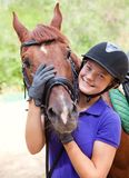 Girl with horse Stock Images